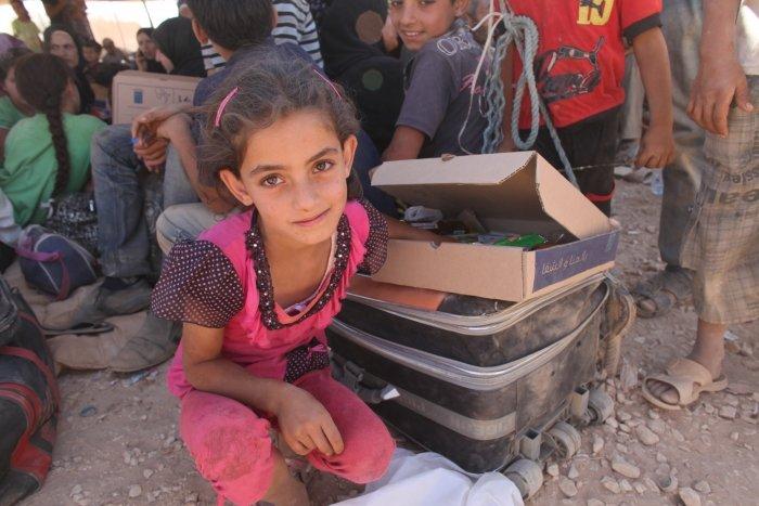 Syrian refugee 7 year old Wiam in Jordan waits