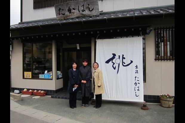 A woman outside her redone kimono shop