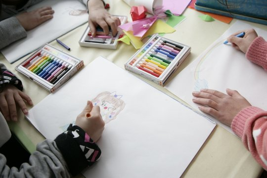 Children Coloring in a Child-Friendly Space