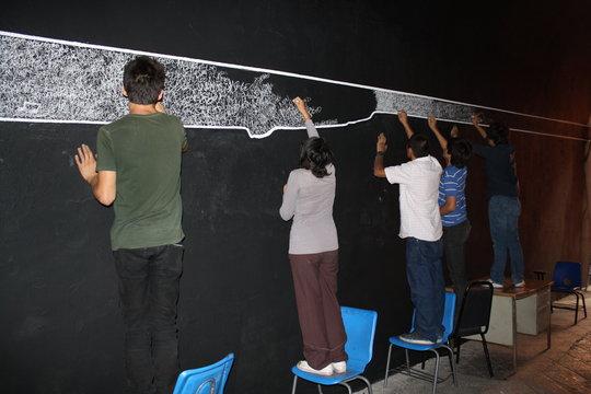 "Students working in mural ""Between Oppositions"""