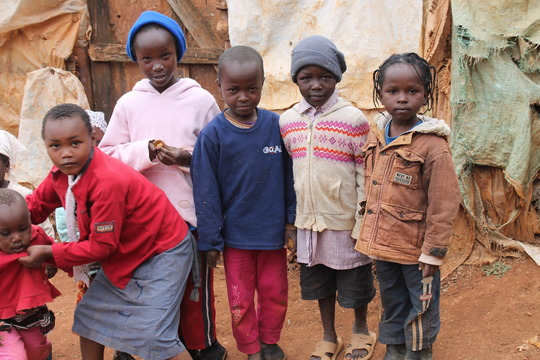 Community kids outside their homes