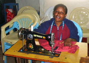 One of 8 Tailoring Trainees