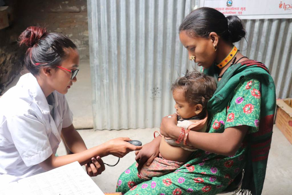 A PHASE Nepal ANM examining a baby