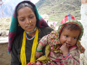 Woman with healthy baby, Maila