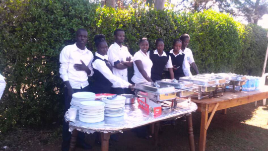 Sergoek - young caterers display goods
