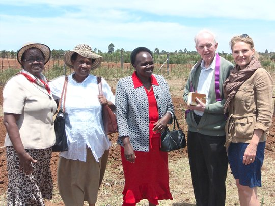 Prof. Margaret Kamar, land donor (in red)
