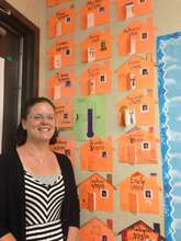 Mrs. Smith and her home visit wall in her class.