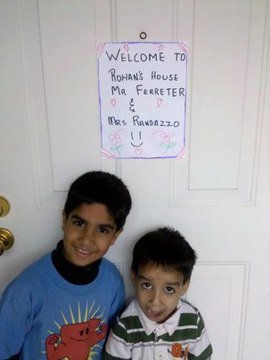 Students welcoming teachers to their home.