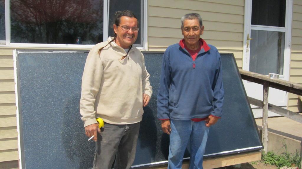 Joe Yellow Hawk (right) with his new solar heater