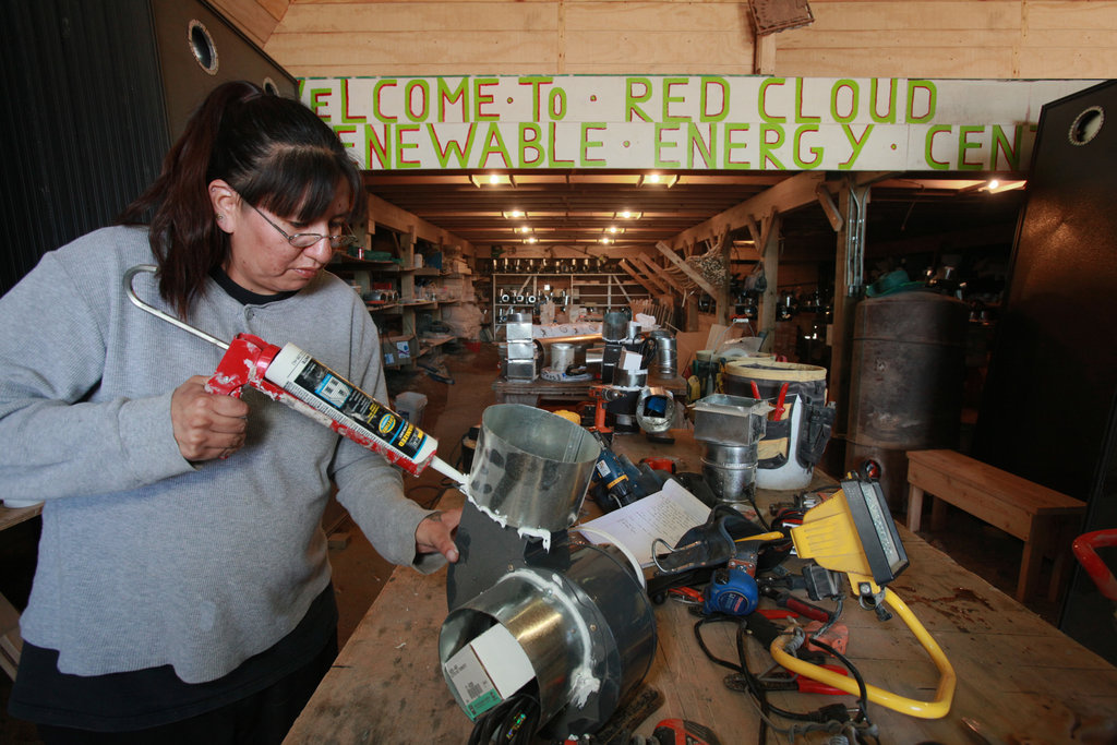 Mary Blue Cloud, a member of the Cheyenne River Sioux Tribe, puts together a small fan that will be used on a solar air heating system. Mary was a trainee at the Red Cloud Renewable Energy Center, a green job training facility operated by Trees, Water & People and our partner Henry Red Cloud.