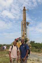 Ben (left) and Charles Odipo with the drill rig