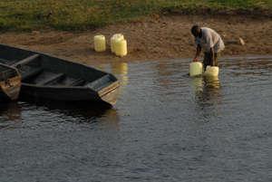 Collecting water at River Yala