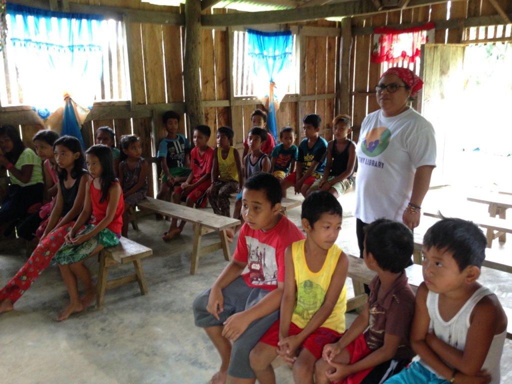 Dingalan children waiting to receive their books