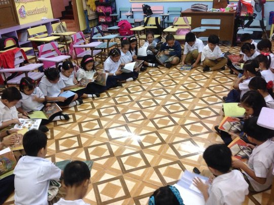 Grade 2 students in a book reading activity
