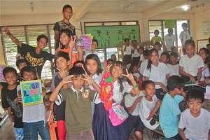 A classroom celebrates the GlobalGiving books!