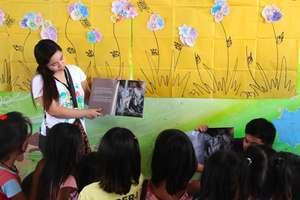 Reading aloud the story of Nadia