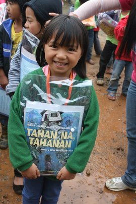 A young reader in Mt. Pulag.