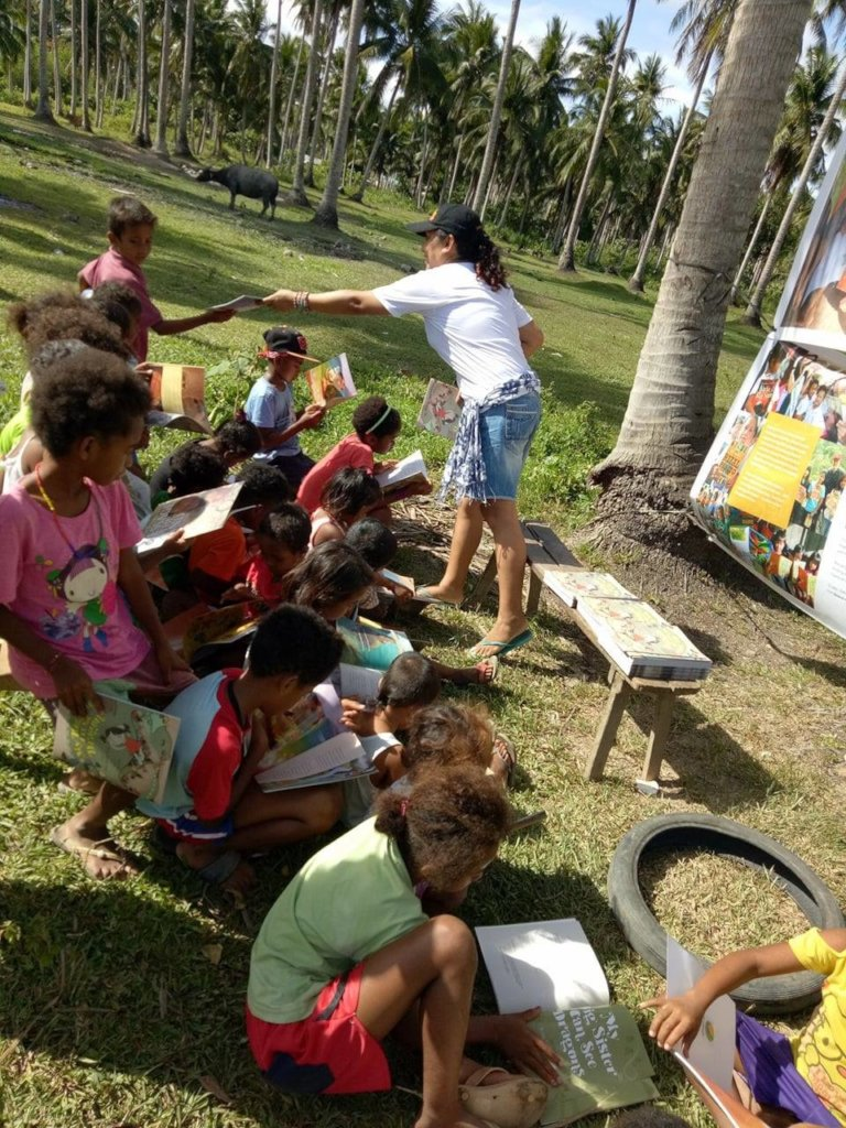 Giving away books in Casiguran
