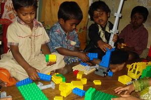 Children building LEGO models