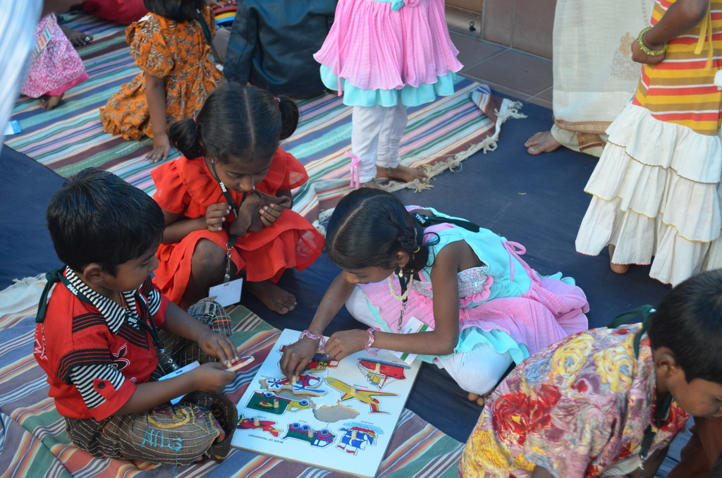 Children using the TLM at an Anganwadi