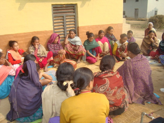 Women are sharing their progress in group meeting