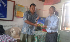 Bhawani Tawa handover the Limbu book to school
