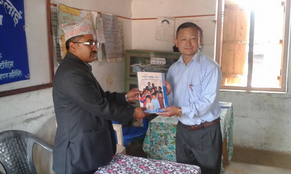 District Education officer handover the MLE manual