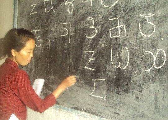 Limbu Women writng Limbu Alphabet