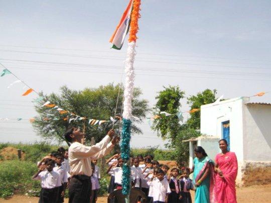 Children saluting the National Flag