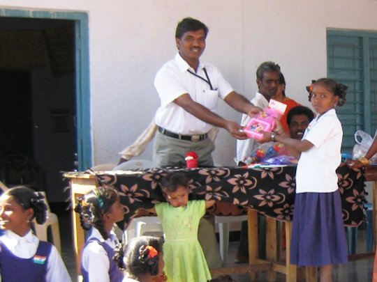 Child Receiving Gift Prize