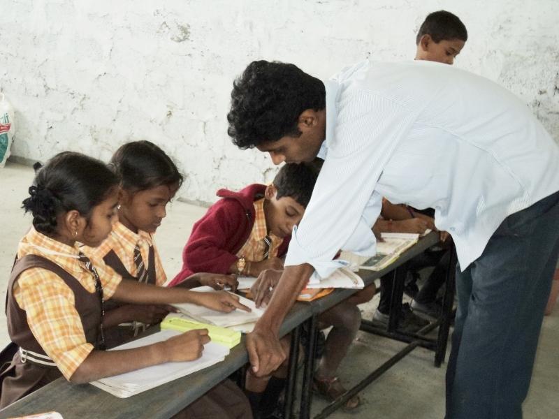 Class teacher guiding our children for studies
