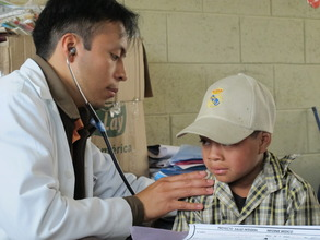 A boy is examined during a Mobile Clinic visit.