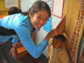 Volunteer Measuring Students for Check-ups