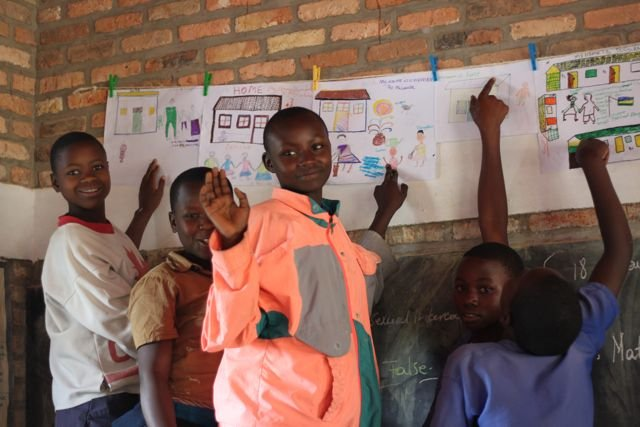 Kids Showing Off Their Work