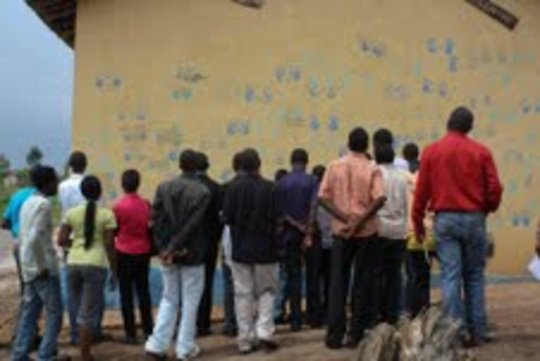 Young Professionals looking at the Dream Wall