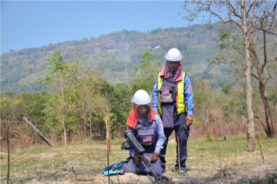 Deminers working on a minefield in NW Cambodia