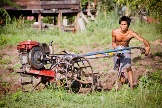 Farmer ploughs cleared ground for the first time.
