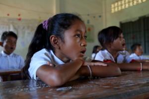 A child studies in Cambodia