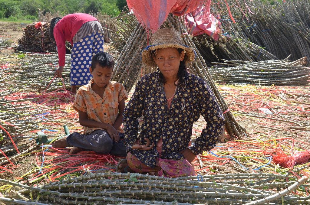 Landmine survivor Savy and her son