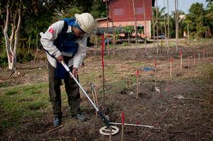 Deminers methodically seek and destroy landmines