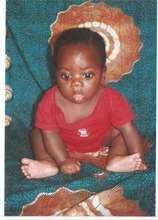 Small boy nourished with champimix porridge