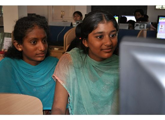 These two girls are students at the Anjana Vidyakendra school in rural India. With access to consistent electricity because of our efforts and that of many others, they can now use computers and have access to modern technology to advance their education. And they seem really interested!