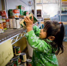 Child picking out food at a Portland food pantry