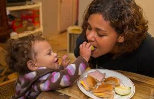 Mom and Child Eat Together