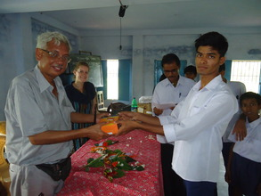 Kushal, Project Resource Person distributes a lamp
