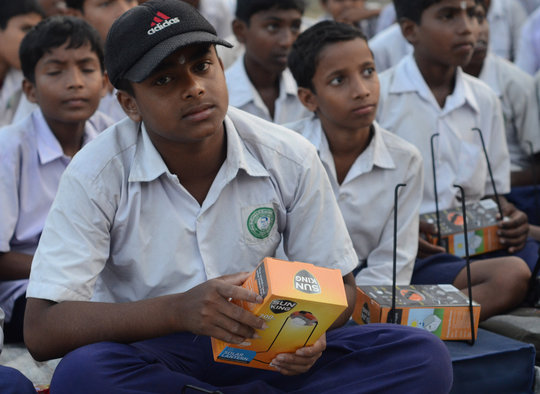 Students with their solar lamps