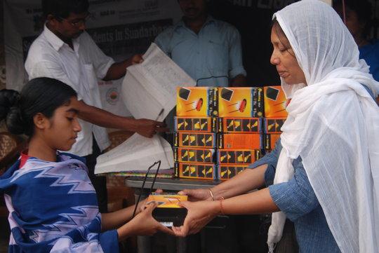 Archana Jalan, a supporter, handing over a lamp