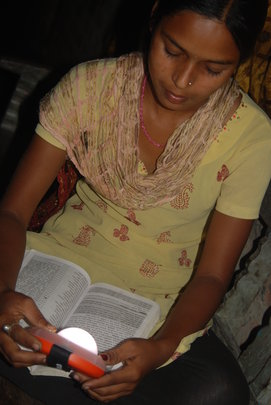 Studying by the light of a solar lamp