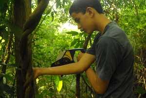 Junior Scientist Joao Pedro collecting tree's data