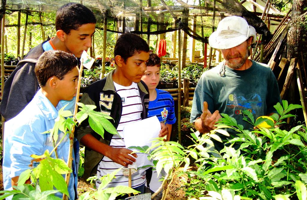 Tony teaching children about tree seedlings